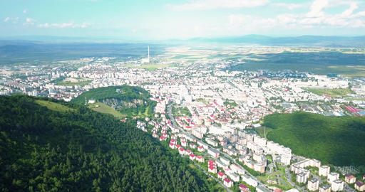 Aerial Drone Flyover Carpathian Mountains And Brasov City Footage