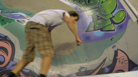 Skateboarder Doing Tricks on Concrete Skatepark Ramp - Slow Motion – Top View Footage