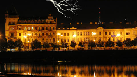 Night scene of the historic waterfront of the Vltava River in Prague during a st Animation