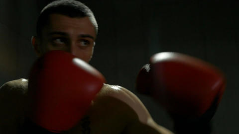 Slow motion of sportsman boxer striking imaginary opponent practicing punches Footage