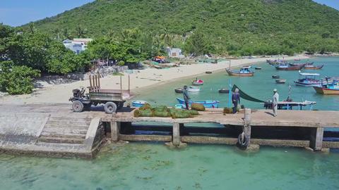 Drone Shows Farmers Drag Algae Sacks along Pier to Pickup ビデオ