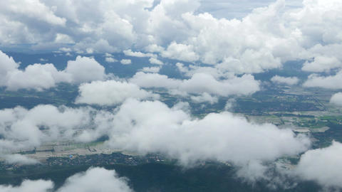 clouds sky and mountain view through an airplane, Flying above Chiang Rai, Thail Footage