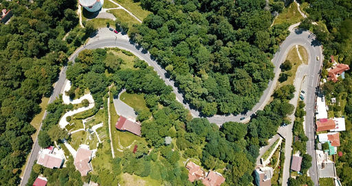 Aerial View Of Curved Roads In Carpathian Mountains Forest Of Transylvania Live Action