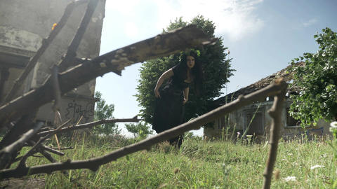 Dreadful witch in black dress and gothic corset walking... Stock Video Footage