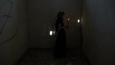 Demonic gothic evil woman turning around holding a candle and angrily screaming  Live Action