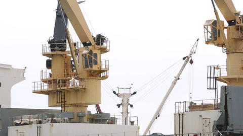 Ship cranes loading cargo Footage
