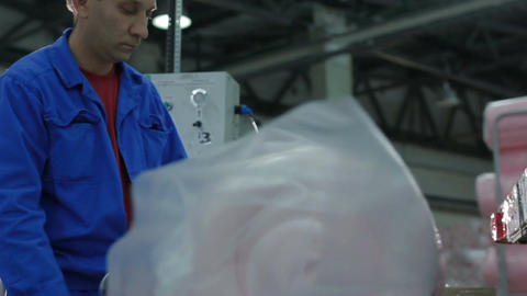 Concentrated Worker Packs Foam Rubber with Adhesive Tape Footage