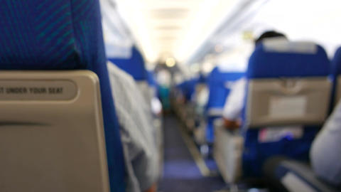 Defocus or Blur of Aircraft cabin. inside airplane with blue Seat Cover Footage