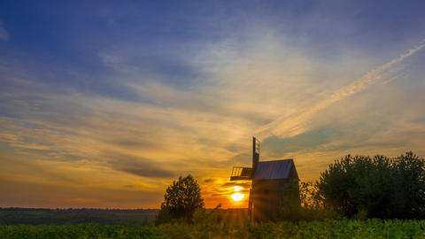 Sunrise and an Old Wooden Windmill. Time Lapse Footage