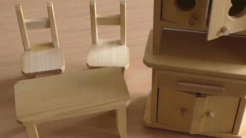 Miniature wooden toy furniture for children. Wooden doll furniture: table, chair Footage