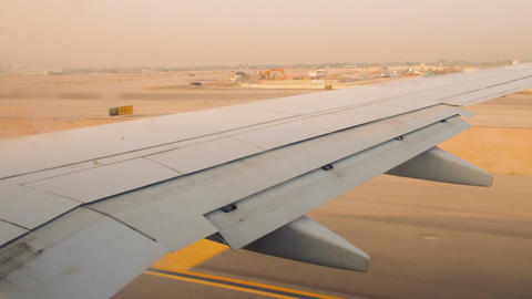 Airplane wing on the runway at ben gurion airport on sunrise Footage