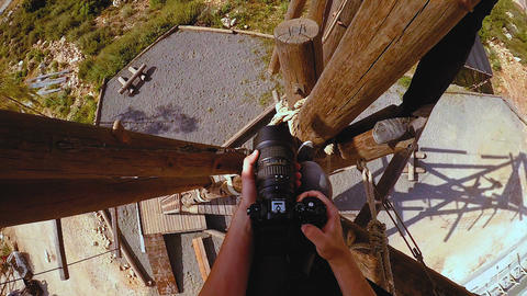 Pov of extreme professional videographer during shooting on climbing tower worki Live Action