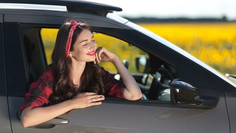 Joyful brunette woman on car summer roadtrip Footage