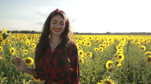Joyful girl with sunflower enjoying nature Footage