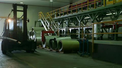 Forklift moving inside warehouse Live Action