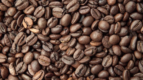 Coffee grains. Vertical and smooth movement of the motorized slide, on the Coffe Footage