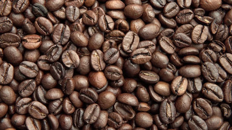 Coffee grains. Horizontal and smooth movement of the motorized slider, on the Co Footage
