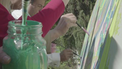 People painting on canvas Footage