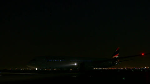 Plane on runway at night Live Action