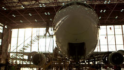 Airplane nose in hanger Live Action