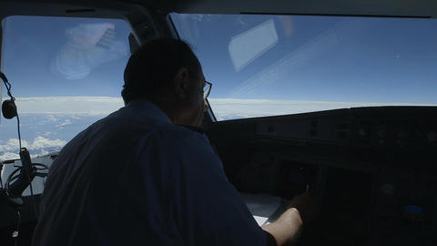 Pilot in cockpit during flight Live Action