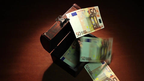 Shadow economy. 50 Euro. Money falls in the ancient chest. 500 Euro banknotes. A Image