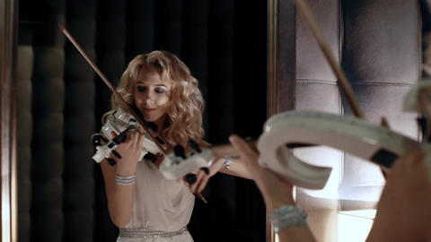 4K Woman Looks in The Mirror And Playing Violin Footage