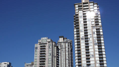 Motion of high-rise residential new buildings on blue sky with 4k resolution Footage