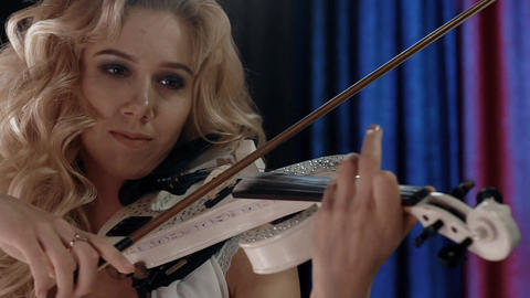 Woman Playing Violin Close-Up Footage