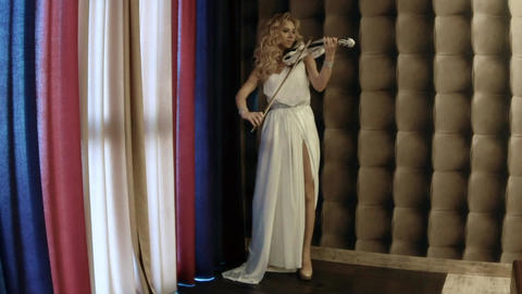 Slow Motion Talented Girl In A Long Dress Plays The Violin Footage