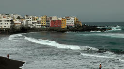 Spain The Canary Islands Tenerife breakwater at shore with black sands beach Footage