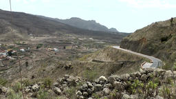 Spain The Canary Islands Tenerife winding road through volcanic landscape Footage