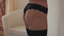 Girl in black panties and black tights. Sexy girl Footage