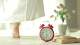 The girl in the Bathrobe goes past the alarm in the morning Footage