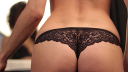 The girl takes off her dress and remains in panties Footage