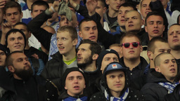 Football fans at the match singing the song. People, crowd, football fans Footage