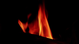 Flame in a fireplace with a dark background 21 Footage