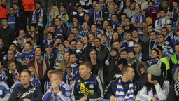 Football fans watching the match at the stadium. People, crowd, football fans Footage