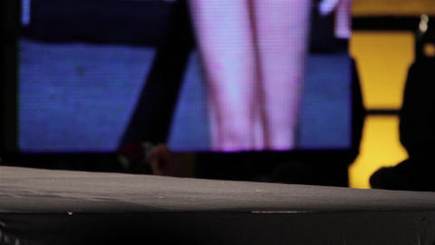 Mannequin legs seen at a fashion parade on a stage located in the center of a to Footage