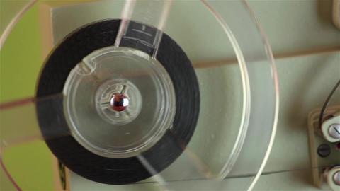 An old 8mm film projector video has been removed from the closet and put back to Footage