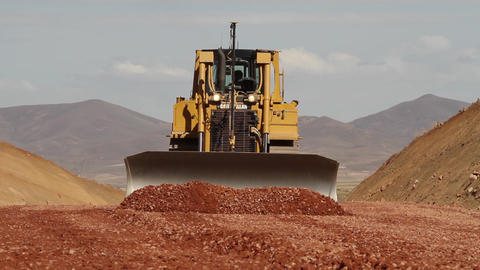 Bulldozer moving soil Live Action