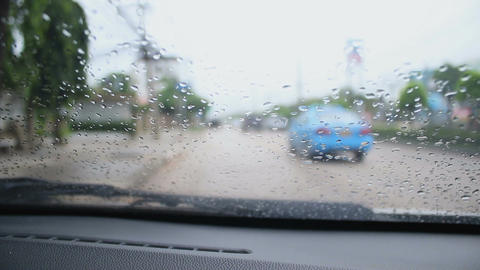 Inside car view blured traffic in rainy day with ambient sound Footage
