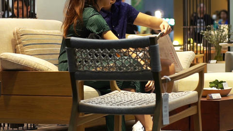 Young Couple looking through furniture sale brochure Live Action