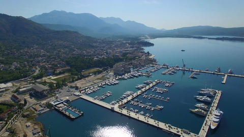 Flying high above Porto Montenegro luxury marina with white yachts, sailing boat Footage