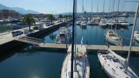 Rising above Porto Montenegro luxury marina pier with white yachts, sailing ビデオ