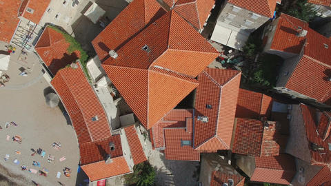 Top view aerial footage of Budva Montenegro old town. Take off and lift above re ビデオ