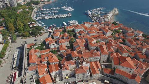 Aerial footage of european old town and modern marina with yachts and sailboats Footage