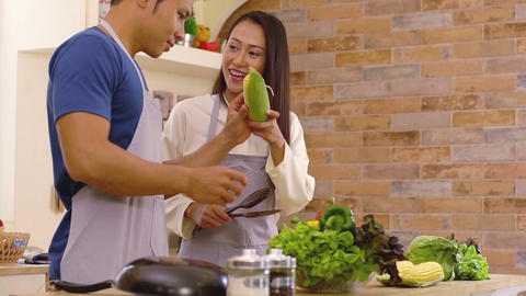 Young Asian Couple in the Kitchen Filmmaterial