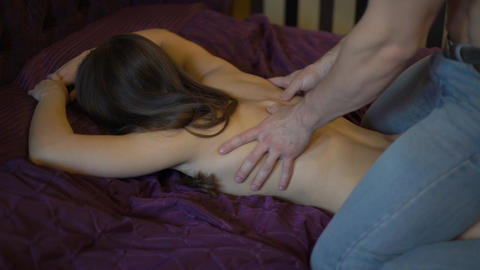 4K Relaxation Massage For Back. Man Rmassaging For Young Female Live Action