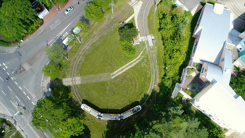 Aerial view of a turning loop with tram Footage